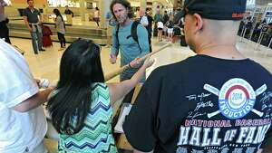 Hall of famer Robin Yount, center, signs autographs for memorabilia collectors after arriving at the Albany International Airport on his way to Cooperstown for Hall of Fame weekend on Thursday, July 24, 2015 in Albany, N.Y. Yount spent his entire 20-year career in Major League Baseball as a shortstop and center fielder for the Milwaukee Brewers.  (Lori Van Buren / Times Union)