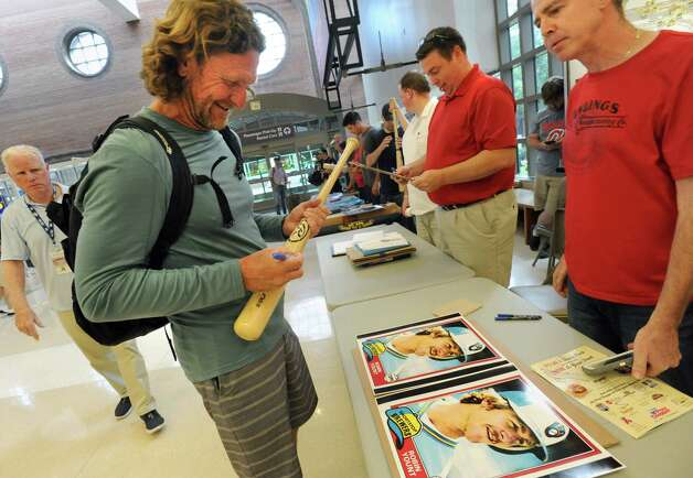 Hall of famer Robin Yount, left, signs a bat for memorabilia collector Jon Waxman of Niskayuna, right, after arriving at the Albany International Airport on his way to Cooperstown for Hall of Fame weekend on Thursday, July 24, 2015 in Albany, N.Y. Yount spent his entire 20-year career in Major League Baseball as a shortstop and center fielder for the Milwaukee Brewers.  (Lori Van Buren / Times Union) Photo: Lori Van Buren / 00032750A