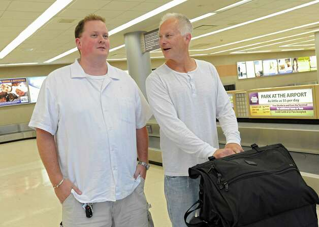 Michael Einarsson of Scotia, left, chats with ESPN sports journalist Kenny Mayne at the Albany International Airport as Mayne heads to Cooperstown for Hall of Fame weekend on Thursday, July 24, 2015 in Albany, N.Y.   (Lori Van Buren / Times Union) Photo: Lori Van Buren / 00032750A
