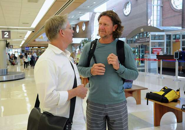 Hall of famer Robin Yount, right, arrives at the Albany International Airport on his way to Cooperstown for Hall of Fame weekend on Thursday, July 24, 2015 in Albany, N.Y. He spent his entire 20-year career in Major League Baseball as a shortstop and center fielder for the Milwaukee Brewers.  (Lori Van Buren / Times Union) Photo: Lori Van Buren / 00032750A