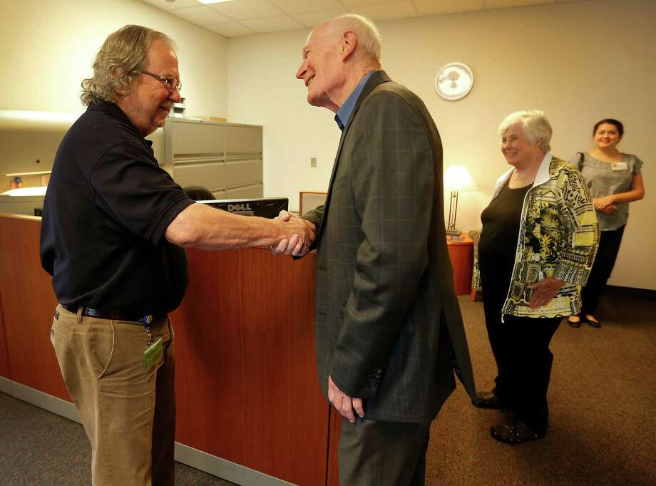 "Campbell, right, gets the chance to thank immunotherapy pioneer Jim Allison. ""I'm a living example of the success of what you've been working on,"" the patient told the scientist last month. Photo: Karen Warren, Staff / © 2015 Houston Chronicle"