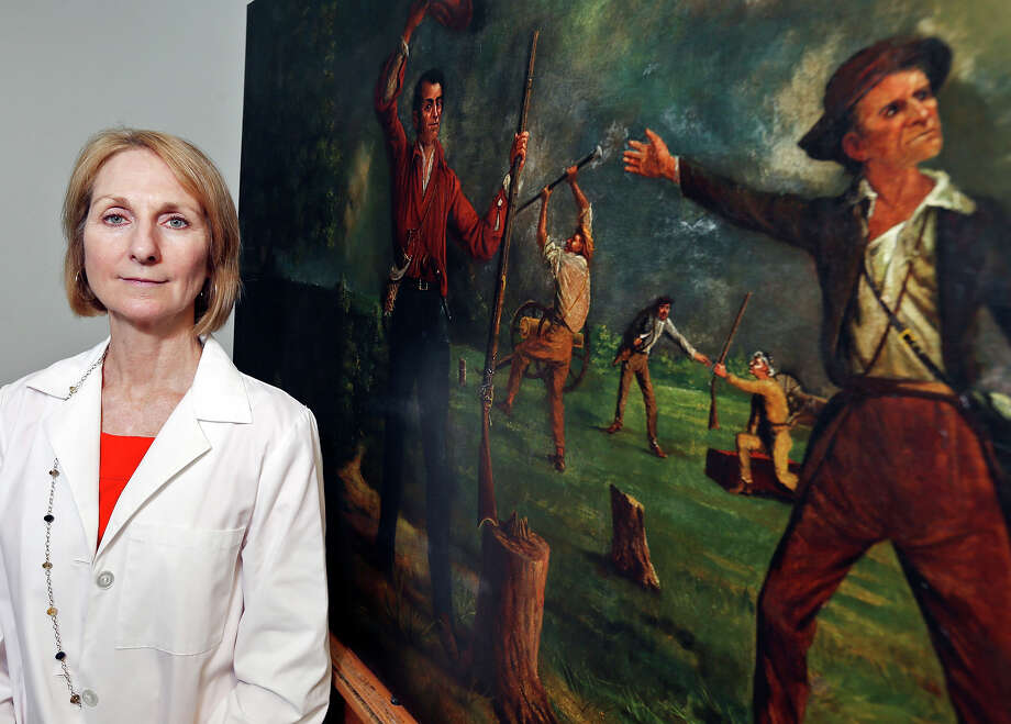 """Portrait of Art Conservator Anne W. Zanikos was working on restoring the 1901 painting """"Ben Milam Calling For Volunteers"""" by Harry Arthur McArdle. The work is now ready to return to the Alamo, and a reader expresses joy at the prospect. Photo: Edward A. Ornelas /San Antonio Express-News / © 2015 San Antonio Express-News"""