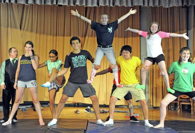 Students take part in a group acrobatic move during the Broadway Bootcamp Circus Arts with Circus Theatricks at The College of Saint Rose on Friday July 24, 2015 in Albany, N.Y. (Michael P. Farrell/Times Union) Photo: Michael P. Farrell / 00032743A