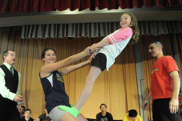 Teachers Seano Fagan, left, and Pat Ferri, right, work with students Laurel Stix,(13) left center, and Annabelle Neidi on acrobatics during the Broadway Bootcamp Circus Arts with Circus Theatricks at The College of Saint Rose on Friday July 24, 2015 in Albany, N.Y. (Michael P. Farrell/Times Union) Photo: Michael P. Farrell / 00032743A