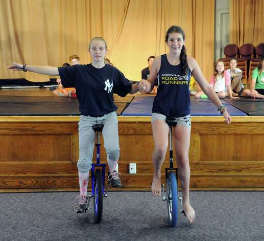Katelyn Micelli, 12, and Laurel Stix,13, practice their unicycle skills during the Broadway Bootcamp Circus Arts with Circus Theatricks at The College of Saint Rose on Friday July 24, 2015 in Albany, N.Y. (Michael P. Farrell/Times Union) Photo: Michael P. Farrell / 00032743A