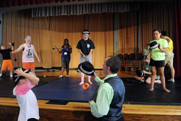 Teacher Seano Fagan, center, works with students during the Broadway Bootcamp Circus Arts with Circus Theatricks at The College of Saint Rose on Friday July 24, 2015 in Albany, N.Y. (Michael P. Farrell/Times Union) Photo: Michael P. Farrell / 00032743A