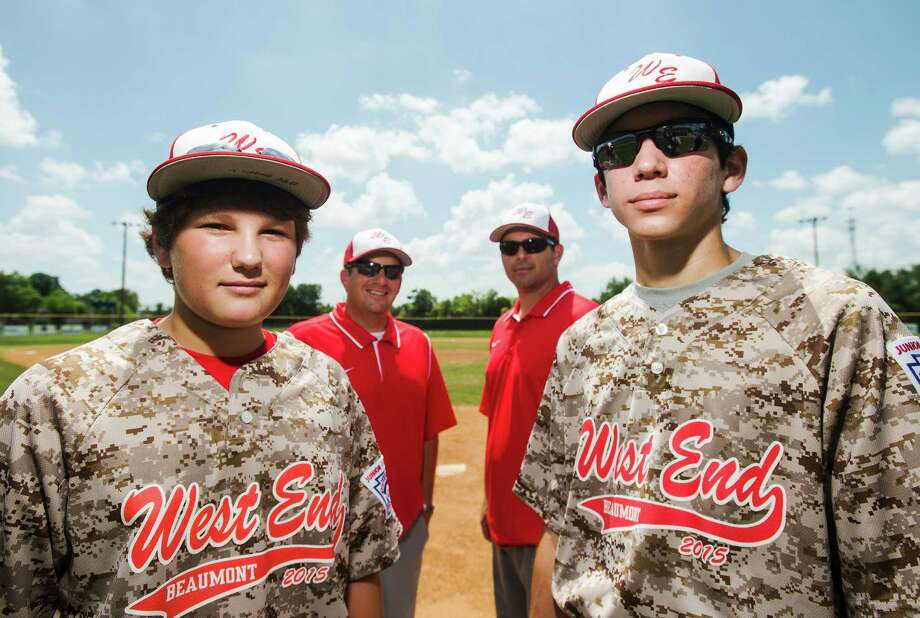 Griffin Cansler, 14, front left, and Tripp Daleo, 14, front right, pose for a photo with their fathers, Brian Cansler, rear left, and Bernie Daleo, rear right, on Friday. Griffin and Tripp play on their same team their fathers did in 1986, but the 2015 team has advanced beyond their predecessor's achievements. The West End Little League juniors team is headed to the regional tournament. Photo taken Friday 7/24/15 Jake Daniels/The Enterprise Photo: Jake Daniels / ©2015 The Beaumont Enterprise/Jake Daniels