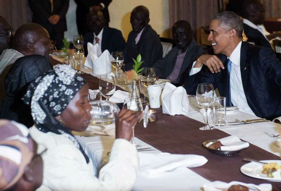 US President Barack Obama attends a gathering of family at his hotel in Nairobi at his hotel in Nairobi, Kenya, July 24, 2015.  US President Barack Obama arrived in the Kenyan capital Nairobi late Friday, making his first visit to the country of his father's birth since his election as president. Obama was greeted by Kenyan President Uhuru Kenyatta with a handshake and embrace as he stepped off Air Force One, at the start of a weekend visit during which he will address an entrepreneurship summit and hold talks on trade and investment, counter-terrorism, democracy and human rights.  AFP PHOTO / SAUL LOEBSAUL LOEB/AFP/Getty Images Photo: SAUL LOEB, Staff / AFP / Getty Images / AFP