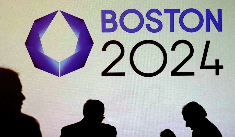 FILE - In this Jan. 21, 2015 file photo, shadows of organizers and reporters pass a video display screen prior to a news conference by organizers of Boston's campaign for the 2024 Summer Olympics in Boston. Organizers of Boston's bid for the games are in a sprint to the finish, scrambling to improve lackluster poll numbers ahead of a September 2015 deadline to formally throw the city's name into the mix to hold the games. (AP Photo/Charles Krupa, File) ORG XMIT: BX101 Photo: Charles Krupa / AP