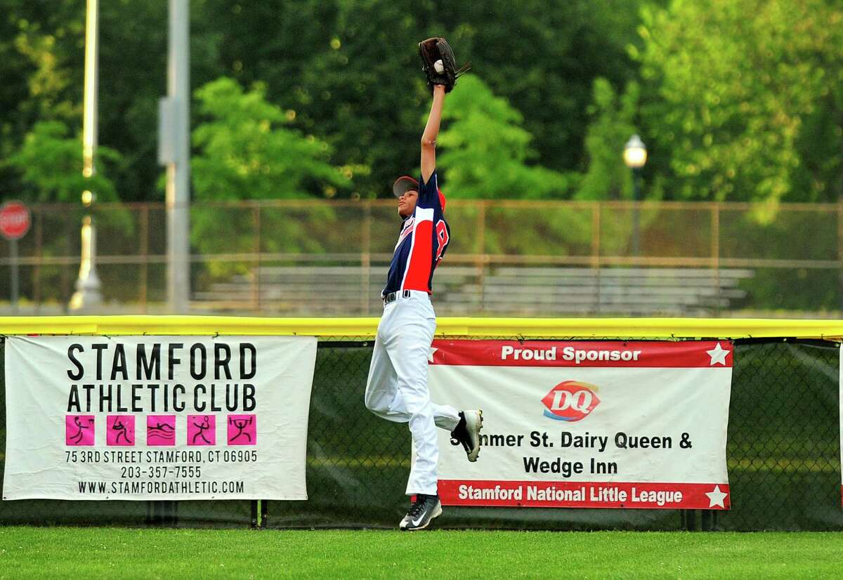 Stamford North left fielder Ethan Davis makes a leaping catch, during little league tournament action against Hamden at Scalzi Park in Stamford, Conn., on Friday July 24, 2015.