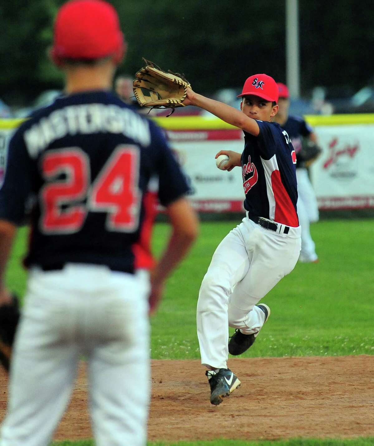 Stamford North shortstop Dave Collazo sends the ball to first, during little league tournament action against Hamden at Scalzi Park in Stamford, Conn., on Friday July 24, 2015.