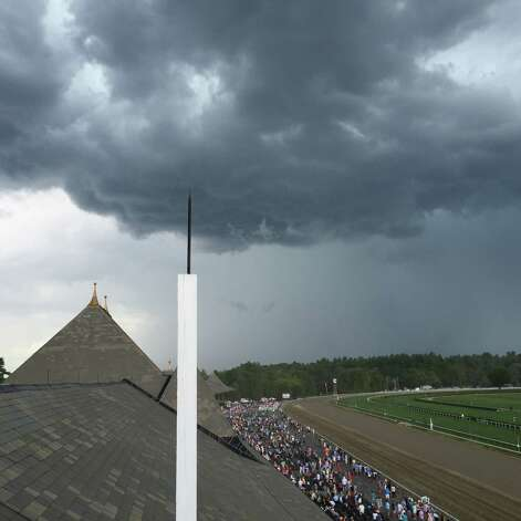Opening day at Saratoga was spectacular in the morning. Not so much as the day went on. This photo of threatening skies over the Spa was taken right after the Schuylerville Stakes was run as the fourth race on the card. Track announcer Larry Collmus told the crowd that a tornado warning had been given for Saratoga Springs by the National Weather Service. For a minute, I thought everyone in heaven was protesting the cramped backyard area. In the end, there was no storm. A little rain spit, but the menacing clouds just passed over the old track. Which was nice. —Tim Wilkin
