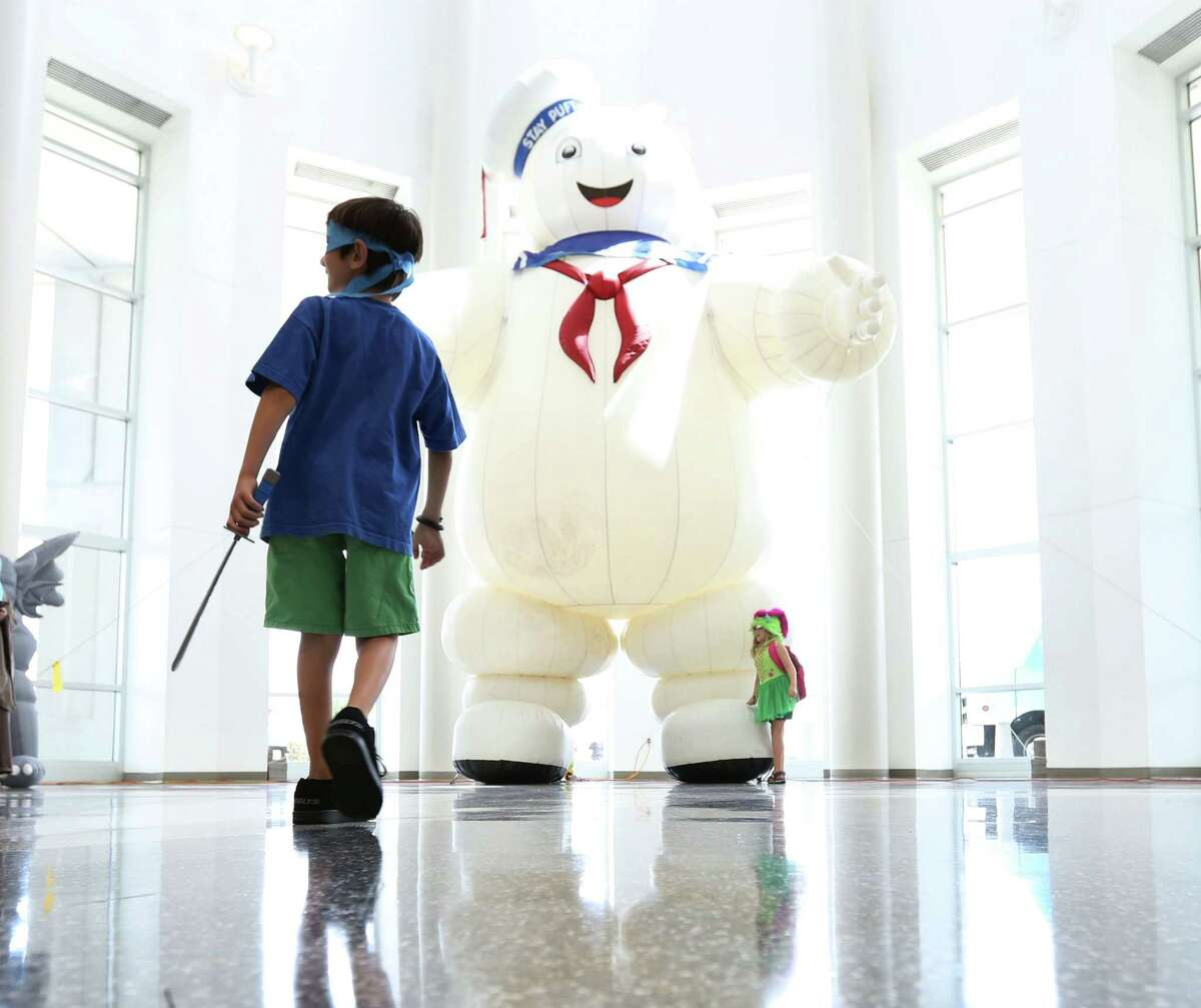 The people of Space City Comic Con 2015 Leo Ulrich, 9, left, and his sister Izzie, 7, play in front of a large inflated character at the 2015 Space City Comic Con at NRG Center Friday, July 24, 2015, in Houston.