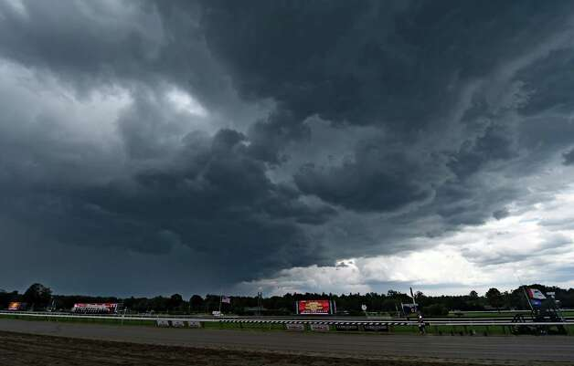 The clouds roll in and the races are delayed briefly Friday July 24, 2015 on opening day at the Saratoga Race Course in Saratoga Springs, N.Y.   (Skip Dickstein/Times Union) Photo: SKIP DICKSTEIN