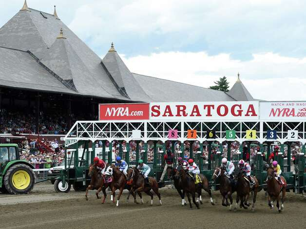 The first race goes off at the Saratoga Race Course Friday afternoon July 24, 2015 in Saratoga Springs, N.Y.  The race was wwon by Sea Raven with Royal Posse second and Beyond Empire to show.  (Skip Dickstein/Times Union) Photo: SKIP DICKSTEIN