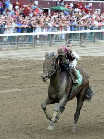 The first race goes off at the Saratoga Race Course Friday afternoon July 24, 2015 in Saratoga Springs, N.Y.  The race was won by Sea Raven with jockey John Velazquez with Royal Posse placed and Beyond Empire to show.  (Skip Dickstein/Times Union) Photo: SKIP DICKSTEIN