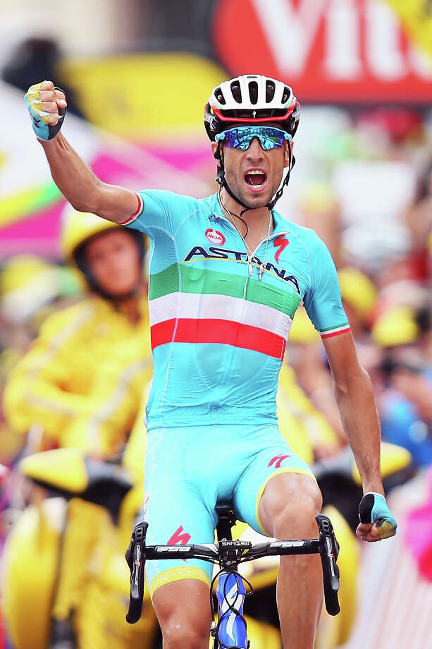 LA TOUSSUIRE-LES SYBELLES, FRANCE - JULY 24:  Vincenzo Nibali of Italy and Astana Pro Cycling celebrates winning stage nineteen of the 2015 Tour de France, a 138km stage between Saint-Jean-de-Maurienne and La Toussuire-Les Sybelles, on July 25, 2015 in La Toussuire-Les Sybelles, France.  (Photo by Bryn Lennon/Getty Images) ORG XMIT: 560076819 Photo: Bryn Lennon / 2015 Getty Images