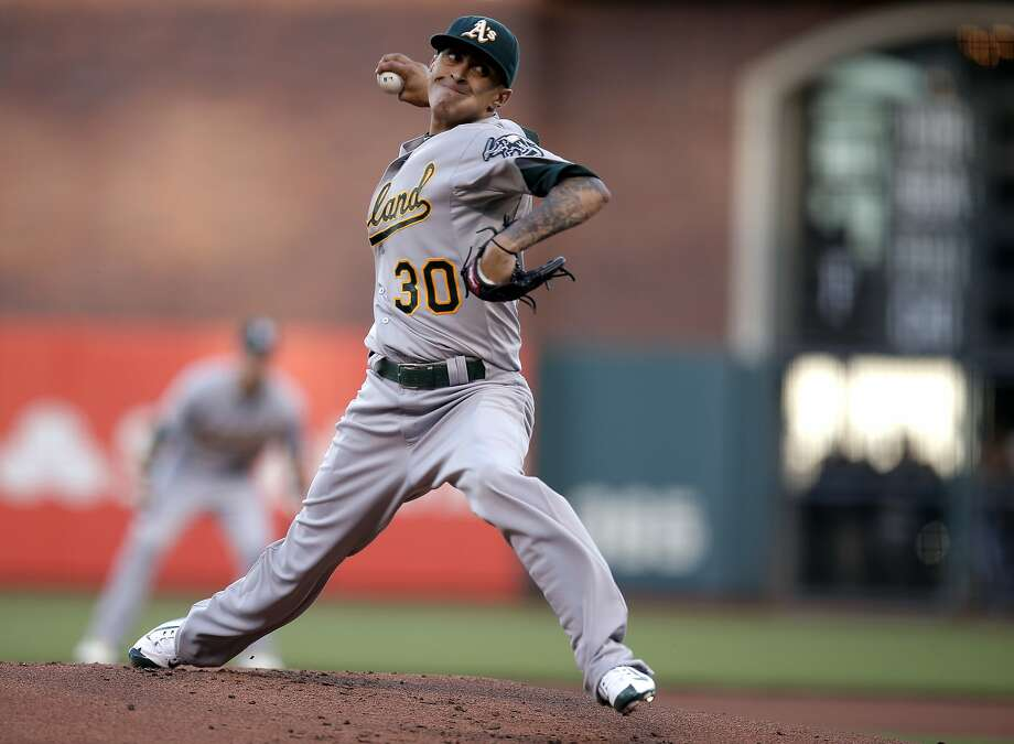 Athletics starting pitcher Jesse Chavez, 30 throws in the first inning, as the San Francisco Giants take on the Oakland Athletics at AT&T Park  in San Francisco, Calif. on Fri. July 24, 2015. Photo: Michael Macor, The Chronicle