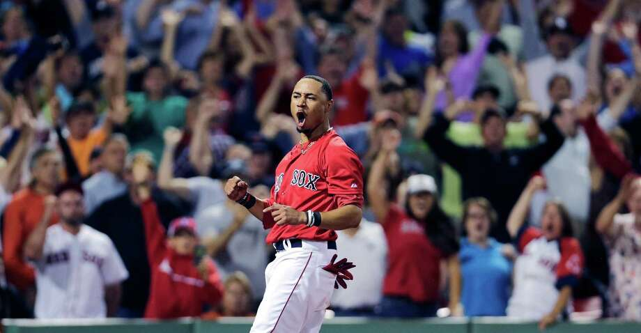 Boston Red Sox's Mookie Betts and fans celebrate after he scored on a single by Xander Bogaerts against the Detroit Tigers during the 11th inning of a baseball game at Fenway Park in Boston, Friday, July 24, 2015. The Red Sox defeated the Tigers 2-1. (AP Photo/Charles Krupa) ORG XMIT: MACK119 Photo: Charles Krupa / AP