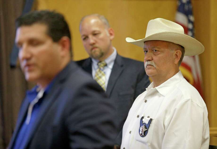 Multiple guns were stolen in 2015 from the vehicle of Waller County Sheriff R. Glenn Smith, right. Commissioners later called for a weapons inventory review. Photo: Melissa Phillip, Staff / © 2015  Houston Chronicle