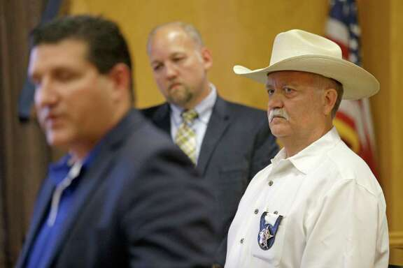 """Waller County Sheriff R. Glenn Smith, right, who has faced allegations of racism and bias, said, """"The whole nation ... is looking at us"""" to make improvements."""