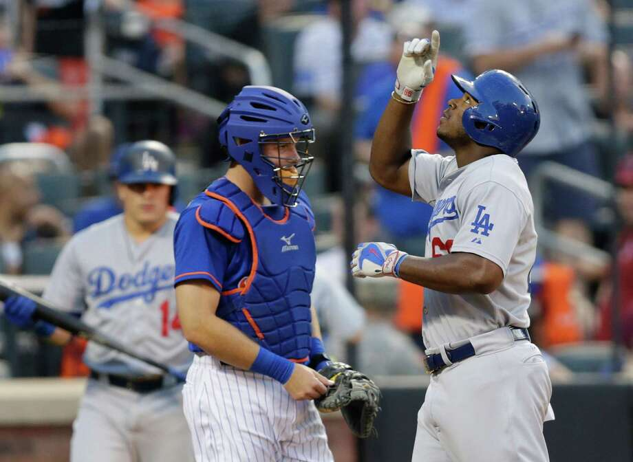 Los Angeles Dodgers' Yasiel Puig gestures as he passes New York Mets catcher Kevin Plawecki after hitting a two-run home run during the third inning of a baseball game Friday, July 24, 2015, in New York. (AP Photo/Frank Franklin II) ORG XMIT: NYM116 Photo: Frank Franklin II / AP