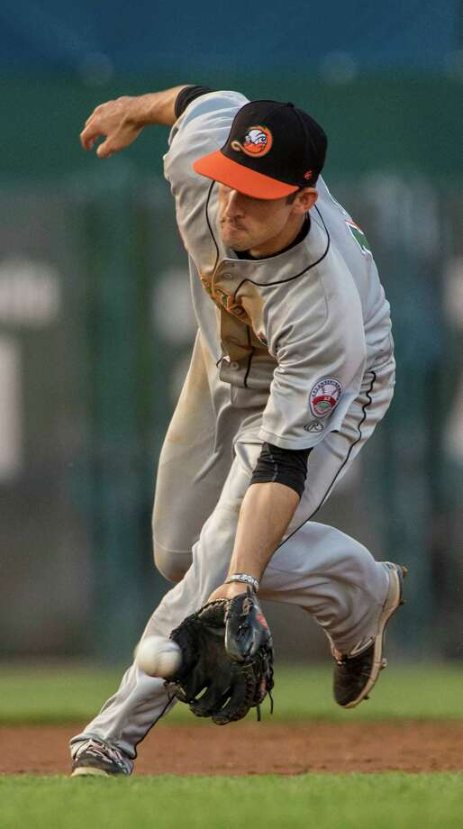 Long Island Ducks shortstop Dan Lyons fields a ground ball during a game against the Bridgeport Bluefish played at the Ballpark at Harbor Yard, Bridgeport, CT on Friday, July 24, 2015. Photo: Mark Conrad / For Heasrt Connecticut Media / Stamford Advocate Freelance