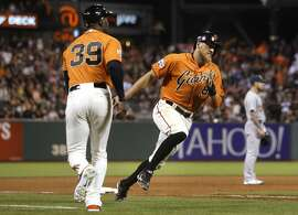 Giants' Hunter Pence, 8 rounds third to score on a Brandon Belt, 9 double in the 5th to make it 6-1 Giants, as the San Francisco Giants take on the Oakland Athletics at AT&T Park  in San Francisco, Calif. on Fri. July 24, 2015.