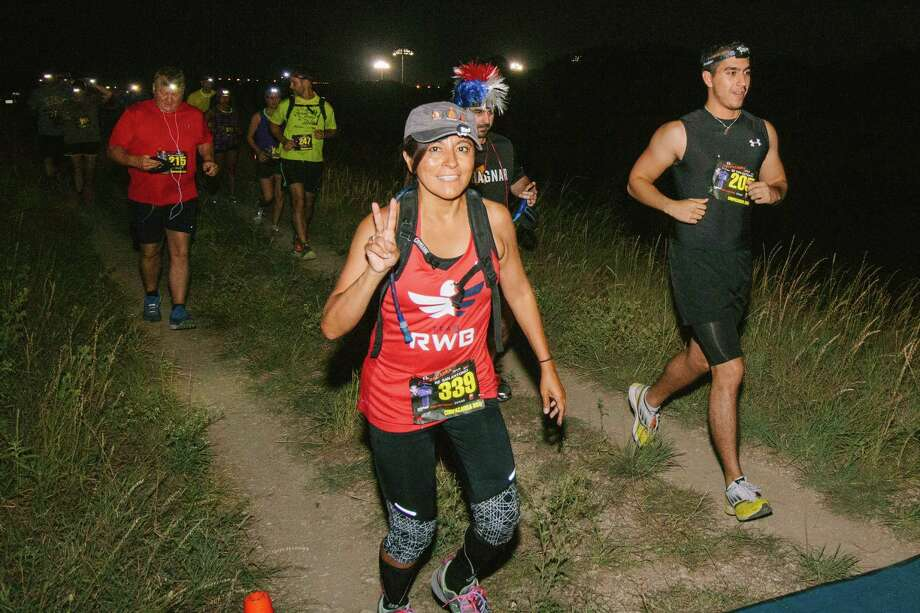 Runners took on the nighttime El Chupacabra de San Antonio 5K and 10K through McAllister Park on Friday, July 24, 2015. Beer and barbecue marked the finish. Photo: Ryan Ibarra