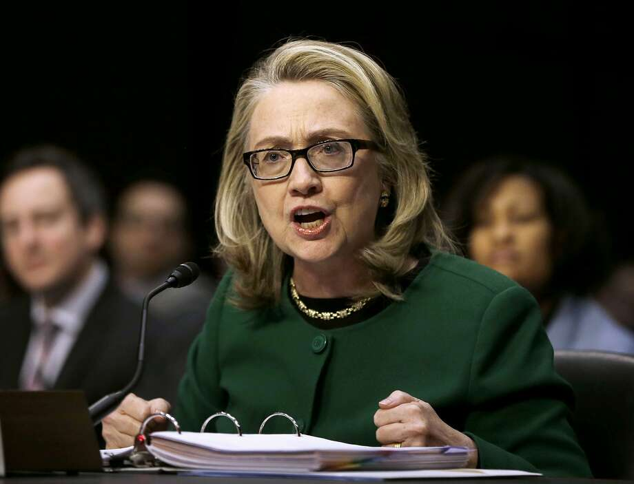 FILE - In this Jan. 23, 2014, then-Secretary of State Hillary Rodham testifies on Capitol Hill in Washington before the Senate Foreign Relations Committee hearing on the deadly September attack on the U.S. diplomatic mission in Benghazi, Libya, that killed Ambassador Chris Stevens and three other Americans.  Senior Obama administration officials, including the White House chief of staff, knew as early as 2009 that Hillary Rodham Clinton was using a private email address for her government correspondence, according to some 3,000 pages of correspondence released by the State Department late Tuesday night, June 20, 2015. But it's unclear whether the officials realized Clinton, now the leading Democratic presidential candidate, was running her email from a server located in her home in Chappaqua, N.Y., a potential security risk and violation of administration policy. (AP Photo/Pablo Martinez Monsivais, File) Photo: Pablo Martinez Monsivais, Associated Press