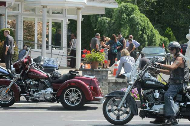 "A host of family and friends and motorcycle community gather at Glenville Funeral Home to pay respect during services for Bryan Herbert and Cynthia ""Cindy"" Marie (Coppola) Blomgren of Rotterdam on Saturday July 25, 2015 in Glenville, N.Y. (Michael P. Farrell/Times Union) Photo: Michael P. Farrell / 00032737A"