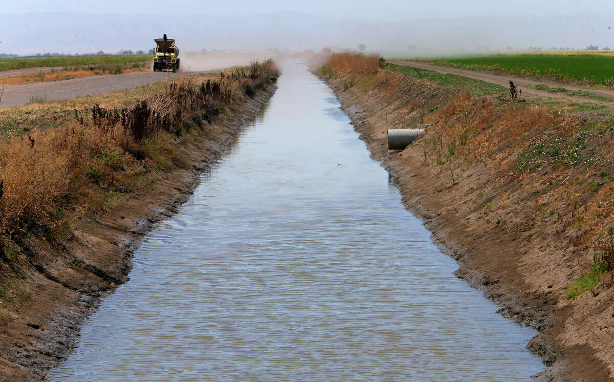 Top: Water from the Sacramento River flows in irrigation canals on the Davis Ranches in Colusa, which have some of the state's oldest water rights.