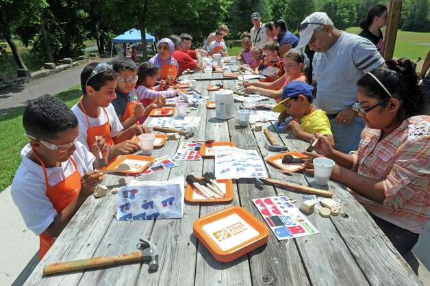 Children work on projects at the Home Depot kids workshop during a festival to celebrate the improvements at Steinmetz Park and begin a new tradition for Goose Hill residents on Saturday July 25, 2015 in Schenectady, N.Y. (Michael P. Farrell/Times Union) Photo: Michael P. Farrell / 00032736A