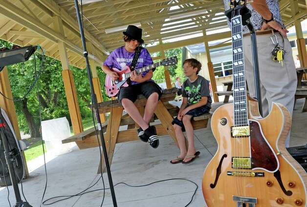 Twelve-year-old Andrew Kuder of Schenectady plays a Blues riff on his guitar during a festival to celebrate the improvements at Steinmetz Park and begin a new tradition for Goose Hill residents on Saturday July 25, 2015 in Schenectady, N.Y. (Michael P. Farrell/Times Union) Photo: Michael P. Farrell / 00032736A