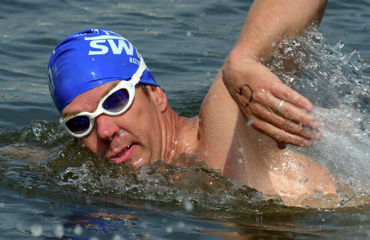 A swimmer makes his way to the finish line during St. Vincent's 28th Annual SWIM Across the Sound marathon at Captain's Cove Seaport in Bridgeport, Conn., on Saturday July 25, 2015.