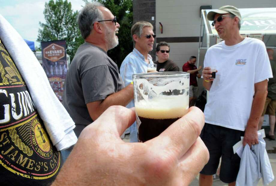 Kevin Ward of Loudonville enjoys a taste of Lake Placid Ubu Ale during the Sixth Annual Capital Region Craft Brewer's Festival at Joe Bruno Stadium on Saturday July 25, 2015 in Troy, N.Y. (Michael P. Farrell/Times Union) Photo: Michael P. Farrell / 00032764A