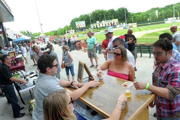 Common Roots Brewing Company of South Glens Falls serves up their brew during the Sixth Annual Capital Region Craft Brewer's Festival at Joe Bruno Stadium on Saturday July 25, 2015 in Troy, N.Y. (Michael P. Farrell/Times Union) Photo: Michael P. Farrell / 00032764A