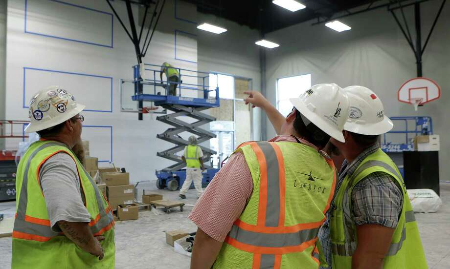 Construction work takes place at the Great Hearts school's gym. In five years, the Great Hearts network hopes to have 6,000 students in six schools in San Antonio. Photo: Bob Owen /San Antonio Express-News / San Antonio Express-News