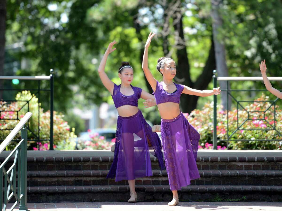 Sydnew Anderson, 13, of Stratford, and Ming-May Hu, 14, of Milford, perform a lyrical dance routine with other students from The Connecticut Dance Conservatory to the song