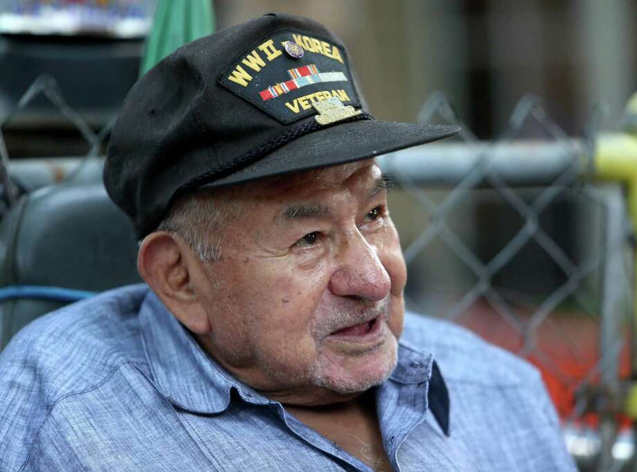 Efren Cerda, a WWII veteran, has his salvageable belongings removed from his home that has fallen in disrepair Saturday, July 25, 2015, in Houston, Texas. Several Veteran's Groups including Gathering Of Eagles, Operation Enduring Brotherhood, Team Rubicon, and Team RWB helped with the move and with a ceremony honoring the fallen servicemen in the recent attacks in Chattanooga. Photo: Gary Coronado, Houston Chronicle / © 2015 Houston Chronicle
