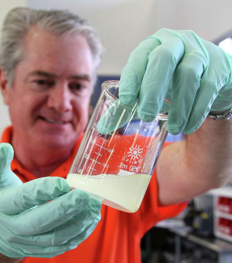 "Jess Hewitt of Gulf Racing Fuels inspects the milky result of ethanol/gasoline blend that has absorbed water from the atmosphere, a precursor to ""phase separation"" that can result in damage to outboard motors. Photo: Picasa"