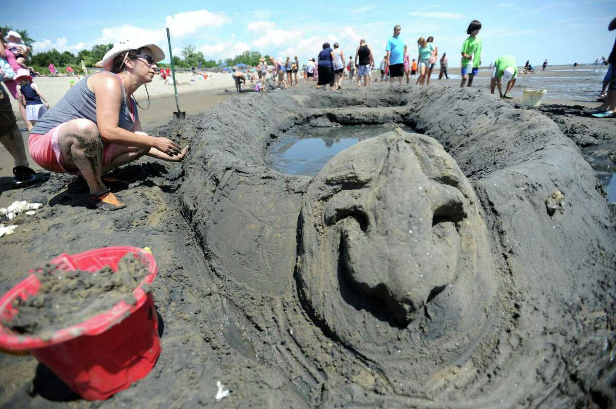 Spectators fill Walnut Beach in Milford for the 38th annual Sand Sculpture competition Saturday, July 25, 2015, sponsored by the Milford Fine Arts Council.