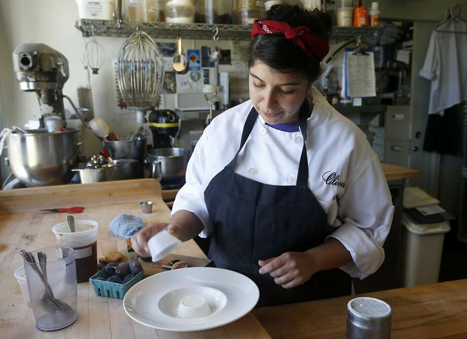 Pastry chef Yakira Batres at Oliveto in Oakland likes to keep some variation of panna cotta on the menu. Photo: Paul Chinn, The Chronicle