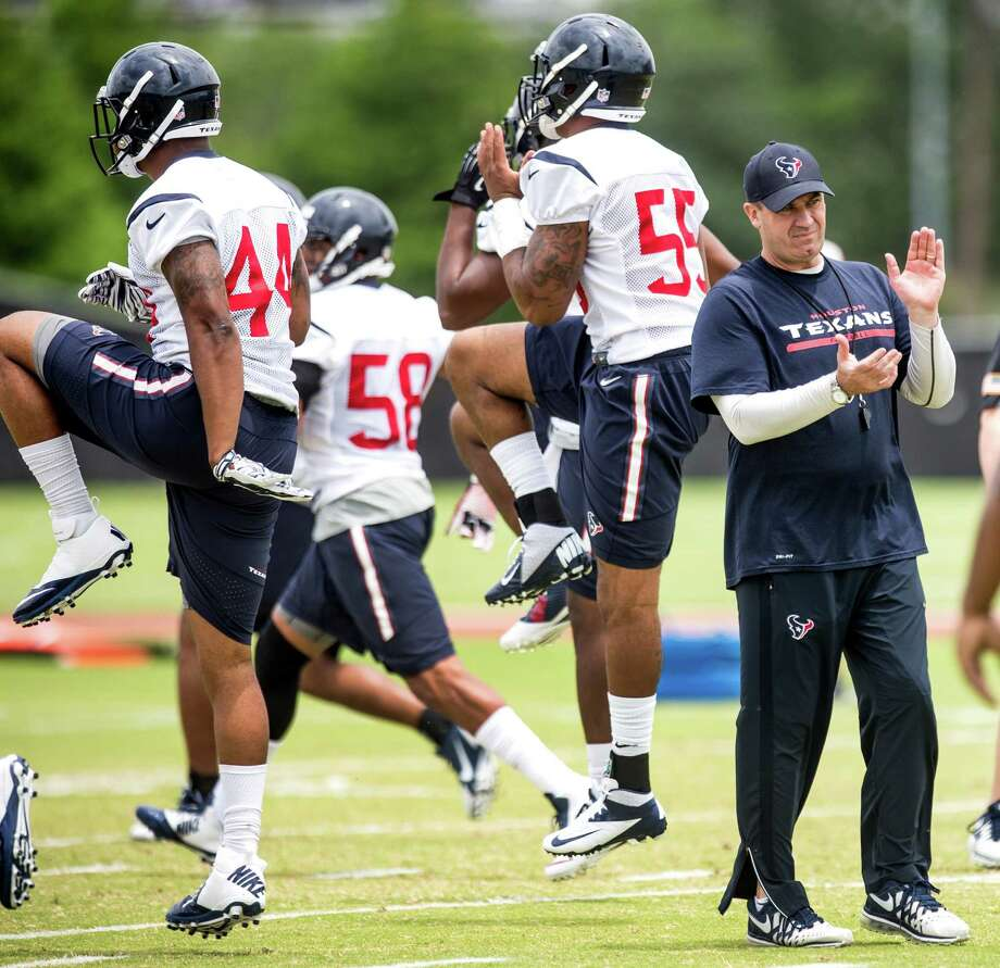 Houston Texans head coach Bill O'Brien, center, claps his hands while watching his players warm up during rookie mini camp at the Methodist Training Center in May. ( Brett Coomer / Houston Chronicle ) Photo: Brett Coomer, Staff / © 2015  Houston Chronicle