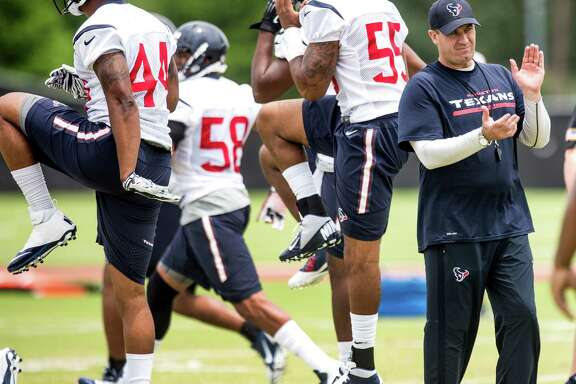 Houston Texans head coach Bill O'Brien, center, claps his hands while watching his players warm up during rookie mini camp at the Methodist Training Center in May. ( Brett Coomer / Houston Chronicle )