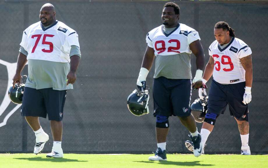 Houston Texans nose tackle Vince Wilfork (75), nose tackle Louis Nix III (92) and defensive tackle Brandon Ivory (69) walk onto the practice field during Texans' organized team activities at the Methodist Training Center Monday, June 1, 2015, in Houston.  ( Brett Coomer / Houston Chronicle ) Photo: Brett Coomer, Staff / © 2015 Houston Chronicle
