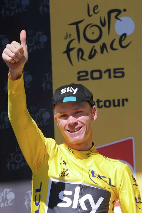 Britain's Chris Froome, wearing the overall leader's yellow jersey, gives a thumbs up as he celebrates on the podium of the twentieth stage of the Tour de France cycling race over 110.5 kilometers (68.7 miles) with start in Modane and finish in Alpe d'Huez, France, Saturday, July 25, 2015. (AP Photo/Christophe Ena) Photo: Christophe Ena, STF / AP