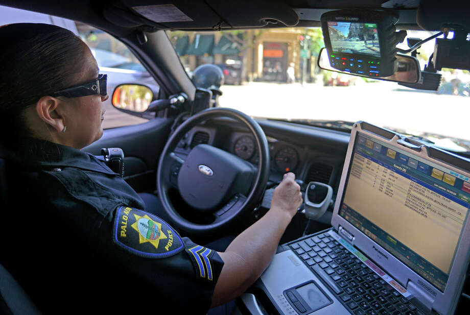 Palo Alto police Officer Marianna Villaescusa uses a camera system that is mounted on the patrol car, continually recording the surroundings from several angles. Photo: Brandon Chew / Brandon Chew / The Chronicle / ONLINE_YES