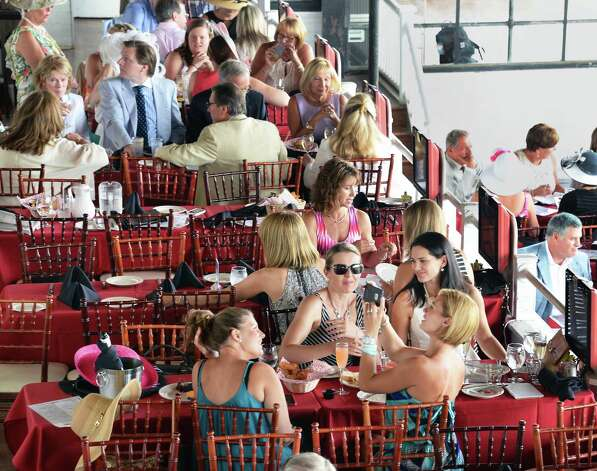 A full dining room in the Turf Terrace on opening day of Saratoga Race Couse Friday July 24, 2015 in Saratoga Springs, NY.  (John Carl D'Annibale / Times Union) Photo: John Carl D'Annibale / 00032725A