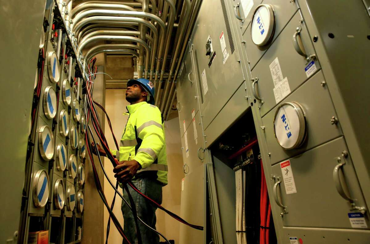 Wayne Thompson, a foreman with Three Brothers Electrical Contractors, works inside one of the electrical rooms at the Shipyard site.